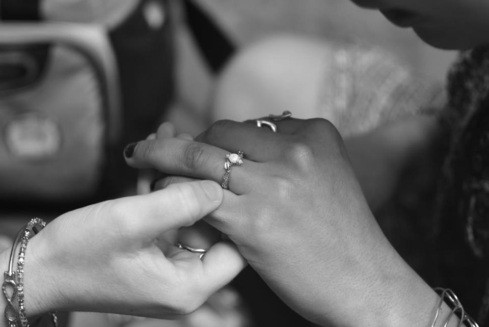 Couple looking at engagement ring by Benati jewelry